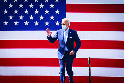 President BIden with American flag background