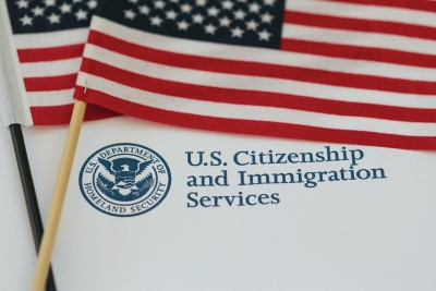 Citizenship document atop 2 American flags